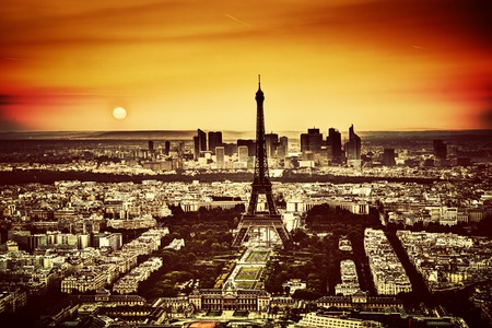 Paris, France at sunset. Aerial view on the Eiffel Tower and the Champ de Mars. Vintage photo