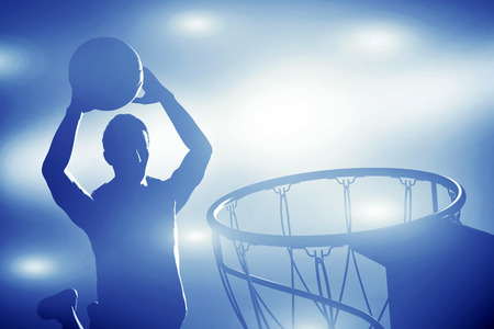 Basketball player silhouette jumping and making slam dunk  Action lights photo