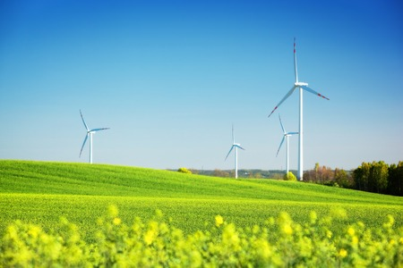 Wind turbines on spring field. Alternative, clean and natural source of energy is gaining pupularity. Eco farm. Фото со стока - 29471185