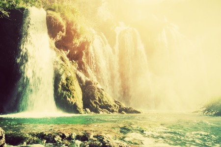 Waterfall in forest. Crystal clear water. Plitvice lakes, Croatia. Vintage, retro style photo