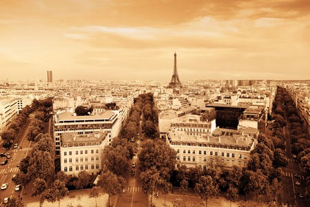 Rooftop view on the Eiffel Tower from Arc de Triomphe. Sunny day, blue sky. Tour Eiffel. Vintage style, monochrome gold photo