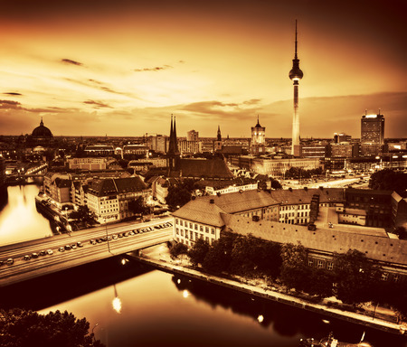 Berlin, Germany rooftop view on Television Tower, Berlin Cathedral, Rotes Rathau and the River Spree - the major landmarks at late sunset in gold tone photo