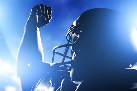 American football player celebrating score and victory. Night stadium lights Foto de archivo