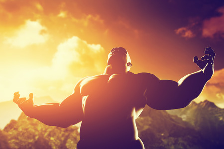 strength: Very muscular strong man with hero, athletic body shape expressing his power and strength on the peak of the mountain at sunset