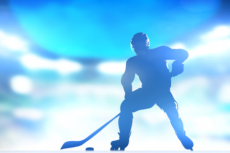 Hockey player skating with a puck. Full arena night lights photo