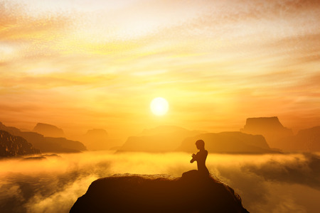 spiritual: Woman meditating in sitting yoga position on the top of mountains above clouds at sunset. Zen, meditation, peace