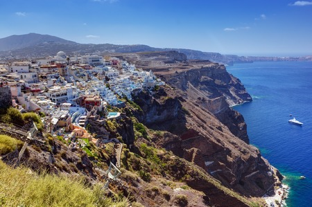 thera: Fira, the capital of Santorini island, Greece. Traditional architecture on cliff over the Aegean sea