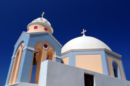 characteristic: A white church in Fira on Santorini island, Greece. Characteristic architecture and famous tourist attraction
