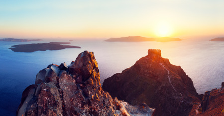 stone volcanic stones: Cliff and volcanic rocks of Santorini island, Greece. View on Caldera and Aegean sea at sunset