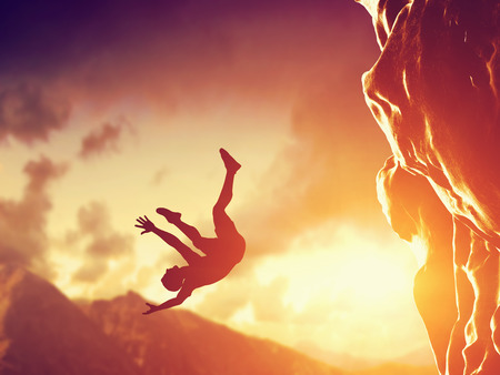 falling: Hiker free falling from the mountain, cliff. Concept of man in dangerous or fatal situation, accident. Stock Photo
