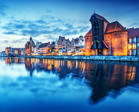 Gdansk old town and famous crane, Polish Zuraw. View from Motlawa river, Poland at romantic sunset, night. The city also known as Danzig and the city of amber. photo