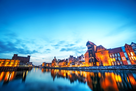 Gdansk old town and famous crane, Polish Zuraw. View from Motlawa river, Poland at romantic sunset, night. The city also known as Danzig and the city of amber. Sky copyspace photo