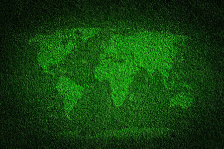 think green: World map on green grass field background. Concepts of ecology, save the earth, environment etc. Stock Photo