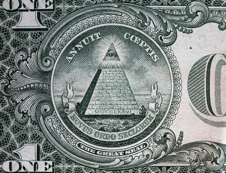 american dollar: Annuit coeptis motto and the Eye of Providence on the reverse side of one American dollar bill.
