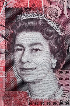 queen elizabeth ii: Queen Elizabeth II portrait on 50 pound sterling banknote. British currency