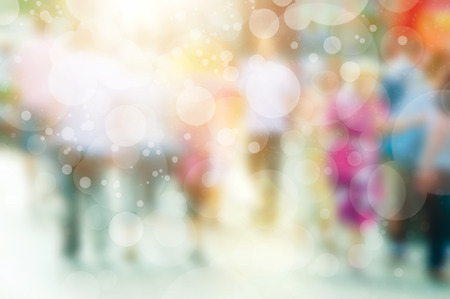 rushing hour: Blurred image of crowd of busy people walking on the street.