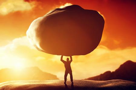 strength: Man lifting a huge rock.
