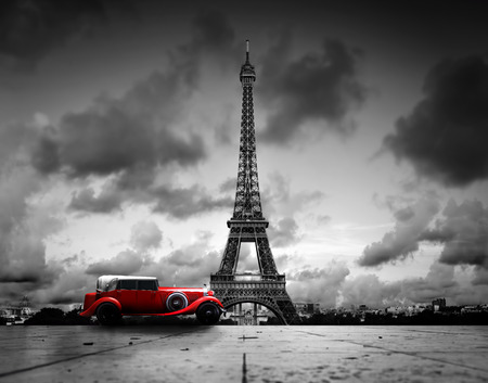 europe: Artistic image of Effel Tower, Paris, France and red retro car. Black and white, vintage.