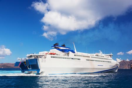 aegean sea: Modern tourist cruise ship sailing on Aegean sea, Santorini island, Greece. Stock Photo