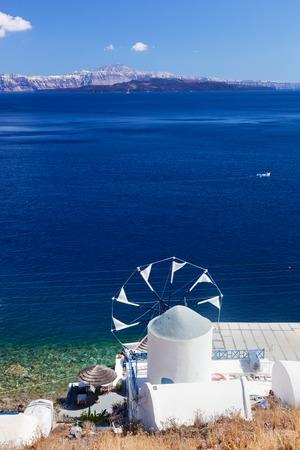 View on windmill and Aegean sea from Therasia island, Santorini, Greece.