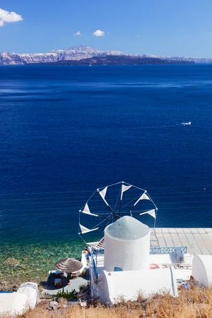 aegean sea: View on windmill and Aegean sea from Therasia island, Santorini, Greece.