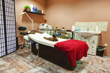 beauty parlor: Beauty salon interior. Relaxing, zen design with table for treatment and massage Editorial