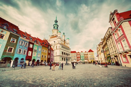 Poznan, Posen market square, old town, Poland. Town hall and colourful historical buildings. Vintage photo