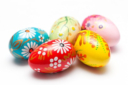 Hand painted Easter eggs isolated on white. Floral, colorful spring patterns and designs. Traditional, artistic and unique. photo