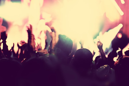 nightclub crowd: Concert, disco party. People with hands up having fun in night club lights. Vintage mood