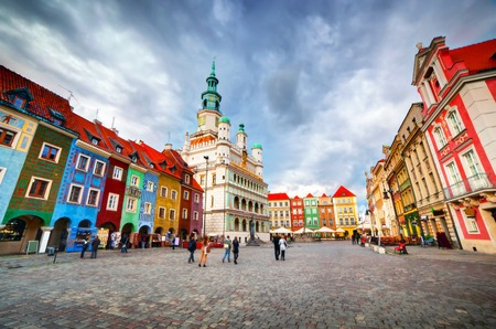 old town guildhall: Poznan, Posen market square, old town, Poland. Town hall and colourful historical buildings. Stock Photo