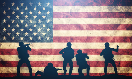 Soldiers in assault on grunge USA flag. American army, military concept.