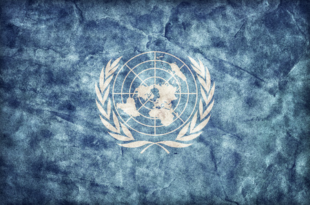 united nations: Grunge United Nations flag, parchment paper texture. UN Stock Photo