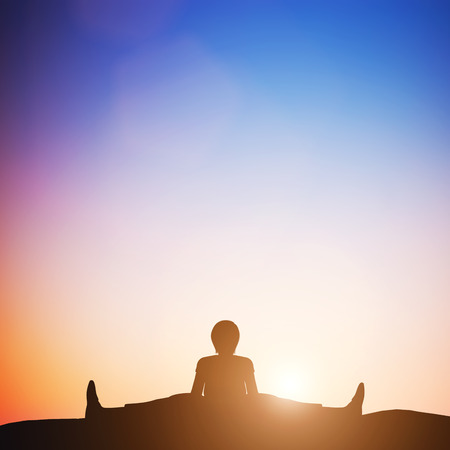 Woman in wide angle bend yoga pose meditating at sunset. Zen, meditation, peace