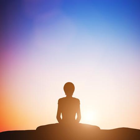 bound woman: Woman in bound angle yoga pose meditating at sunset. Zen, meditation, peace Stock Photo
