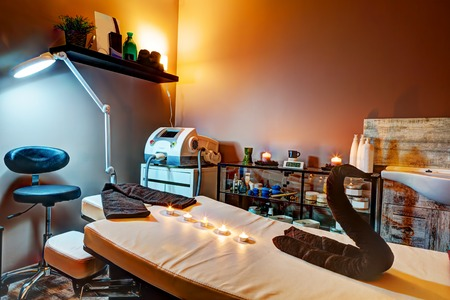 zen interior: Beauty salon interior. Relaxing, zen design with table for treatment and massage Stock Photo