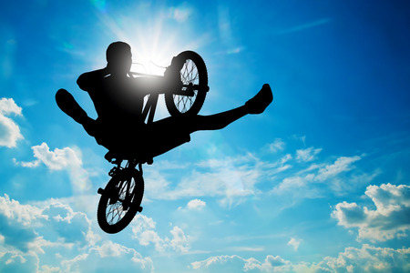bmx bike: Man riding a bmx bike performing a trick Stock Photo