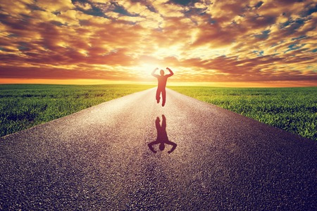 straight man: Happy man jumping on long straight road, way towards sunset sun. Travel, happiness, win, healthy lifestyle concepts.