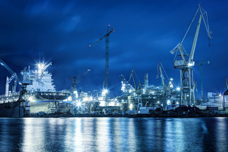 shipping: Shipyard at work, ship repair. Industrial machinery, cranes. Transport, freight concept Stock Photo