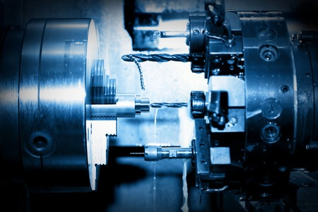 shipbuilder: Industrial CNC drilling and boring machine at work close-up. Industry concept, blue tone. Stock Photo