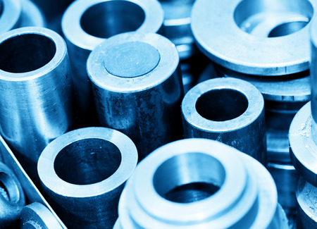 mechanical engineer: Industrial steel cylinders, pistons and tools in workshop. Industry theme. Stock Photo