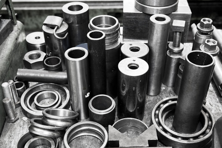 Industrial steel cylinders, pistons and tools in workshop. Industry theme. Stock Photo