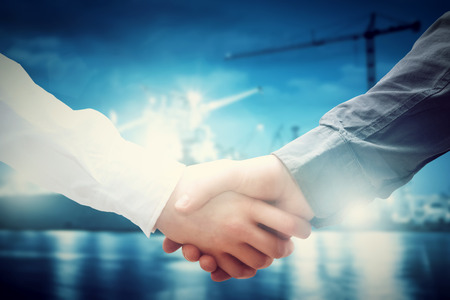Business handshake in shipyard, shipbuilding company. Industry, deal, contract.