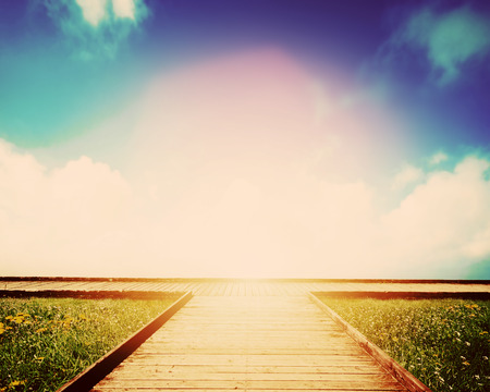 Wooden path leading to crossroads. Direction, way to choose. Concept of decision making, future, environment etc.