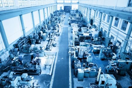 Heavy industry workshop, factory. CNC, boring, threading, drilling machines. Aerial, top view. Blue tone Archivio Fotografico
