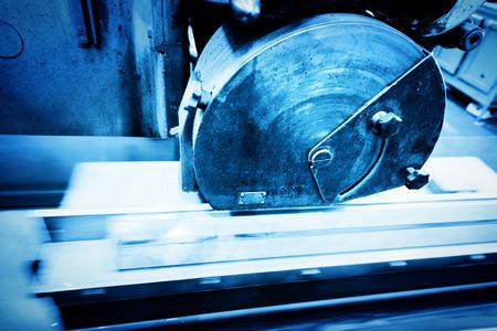 mechanical engineer: Big metal saw at work in workshop. Industrial background, industry.