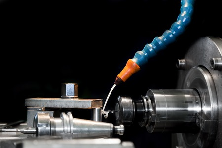 threading: CNC machining station at work. Milling, threading, drilling. Industry, industrial concept.
