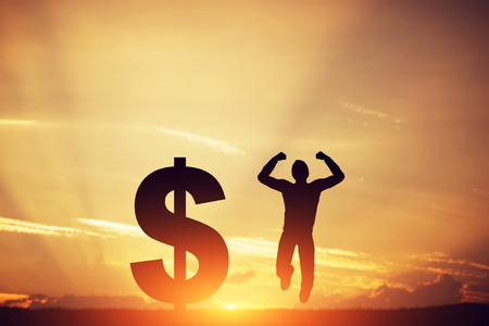 Happy man jumping for joy next to dollar symbol. Winner of lottery, financial business success concept Banco de Imagens