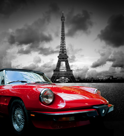 historic vintage: Effel Tower Paris France and retro red car. Black and white Stock Photo