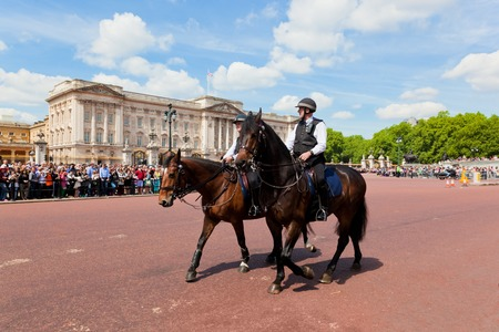 deployed: LONDON - JUNE 24: Metropolitan Police Mounted Branch secure the British Royal Guards change next to Buckingham Palace on June 24, 2015 in London, UK. Police officers on horses are deployed to control crowd