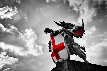 united kingdom: St George dragon statue in London, the UK. Symbol of England. Black and white with red St. Georges Cross